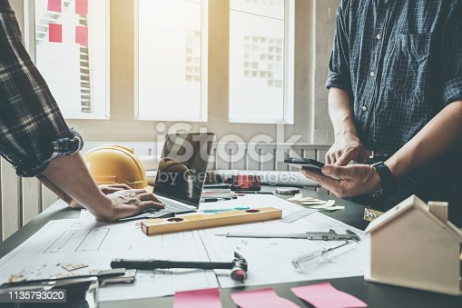 921019684istockphoto Engineer and contractor planning projects together at the meeting. 1135793020