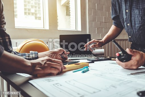 921019684istockphoto Engineer and contractor planning projects together at the meeting. 1135793021