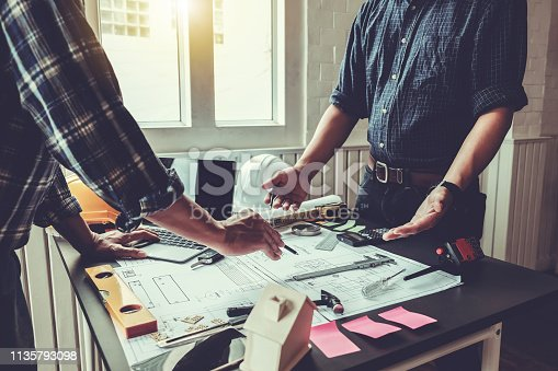 921019684istockphoto Engineer and contractor planning projects together at the meeting. 1135793098
