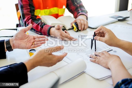 1174841541 istock photo Engineer and contractor planning projects together at the meeting. 1159058776