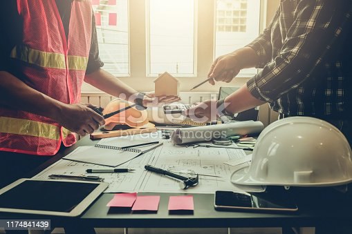 1174841541 istock photo Engineer and contractor planning projects together at the meeting. 1174841439