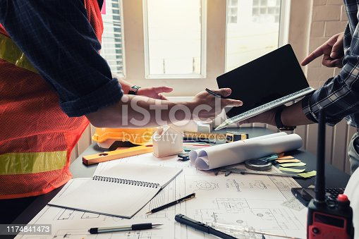 1174841541 istock photo Engineer and contractor planning projects together at the meeting. 1174841473