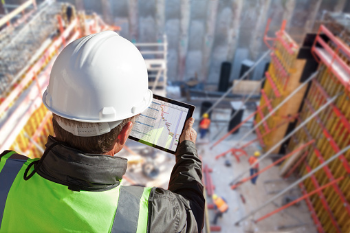top view of construction site with multinational worker