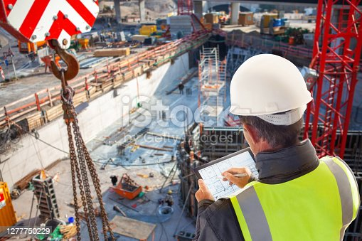 istock engineer architect construction worker on construction site with tablet computer 1277750229