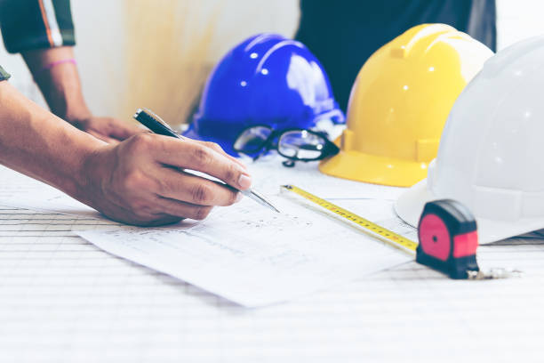 engineer architect working table with safety helmet,design concept . construction safety concept . - civil engineer stock photos and pictures