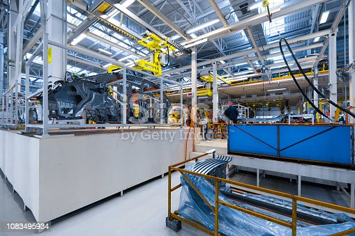 1069360792istockphoto Engineer assemble the car on the production line. Car manufacturing plant 1083495934