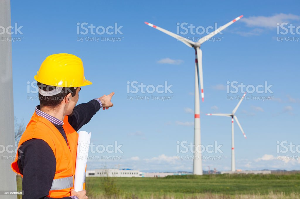 Engineer at Work in Wind Turbine Power Station stock photo