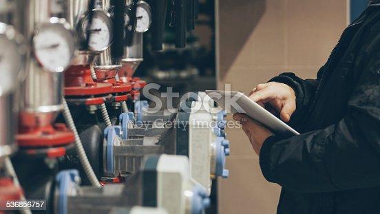 engineer working on maintenance in boiler room