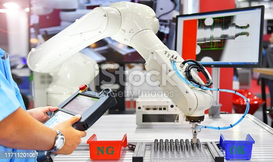 874298574 istock photo Engineer check and control automation Modern Robot system in factory 1171120105