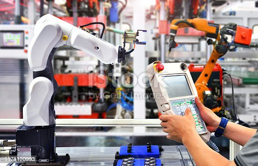 istock Engineer check and control automation Robot arm in factory. 1171120993