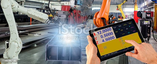 1091790362 istock photo Engineer check and control welding robotics automatic arms machine in intelligent factory automotive industrial with monitoring system software. Panoramic view 1185387182