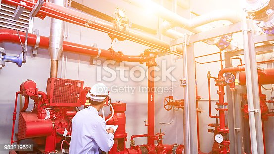 Engineer check red generator pump for water sprinkler piping and fire alarm control system.