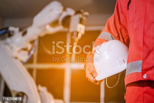 1091790362 istock photo Engineer check welding robotics automatic arms machine. Programming robot with robotic arm. Smart factory. 1192049818