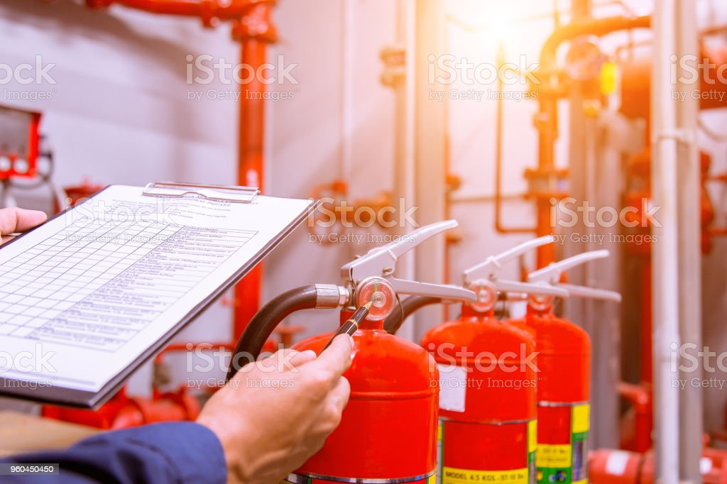Engineer checking Industrial fire control system,Fire Alarm controller, Fire notifier, Anti fire.System ready In the event of a fire. stock photo