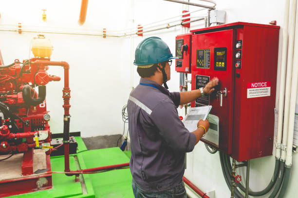 Engineer checking industrial generator fire control system stock photo