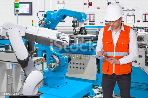 874298574 istock photo Engineer checking maintenance daily of automated robotic in prod 808566430