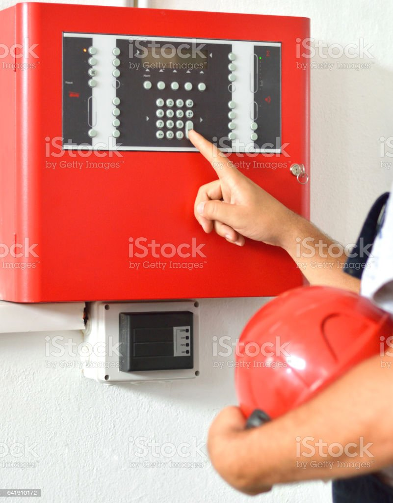 Engineer checking the fire alarm system stock photo