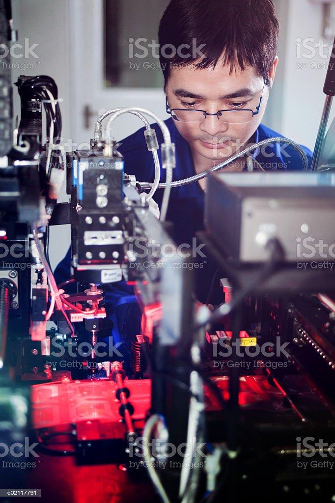 Engineer checking the mechine stock photo