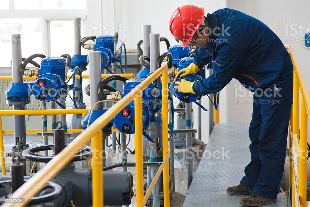 Engineer checking the oil pipeline equipment royalty-free stock photo