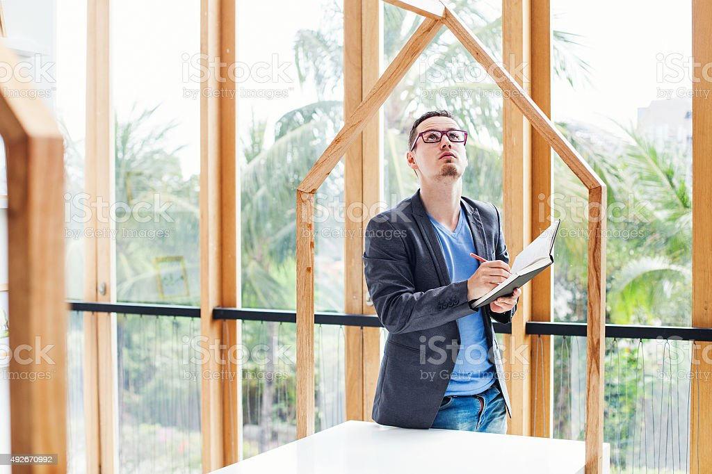 engineer checking the quality of house model stock photo