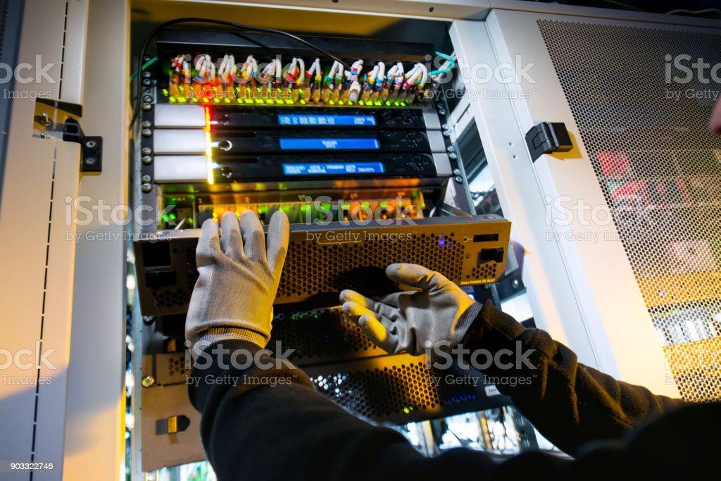 Engineer checks the server stock photo