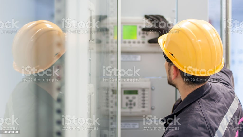 Engineer commissioning bay control unit. Engineering department stock photo