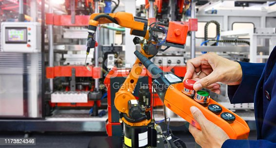 istock Engineer control automation Robot arm machine in factory 1173824346
