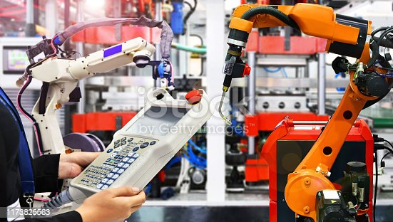 istock Engineer control automation Robot arm machine in factory 1173825563