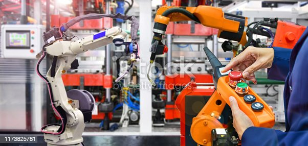 istock Engineer control automation Robot arm machine in factory 1173825781