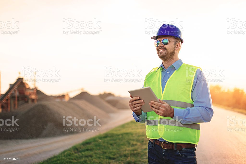 Engineer controling process in mine pit stock photo