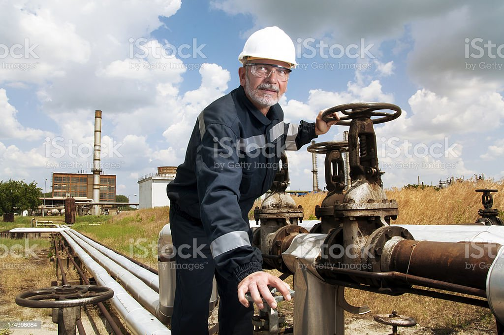 Engineer doing some work in oil refinery royalty-free stock photo