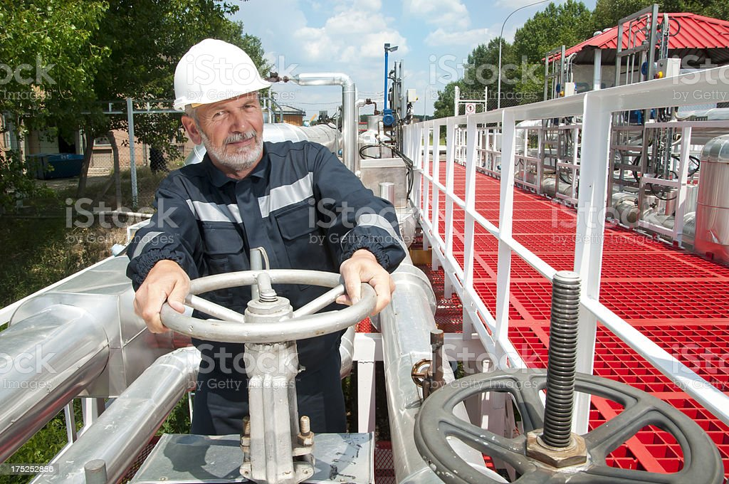 Engineer doing some work in oil refinery stock photo
