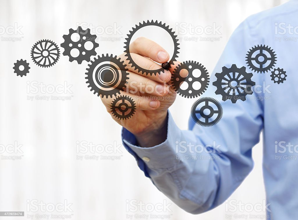 engineer draws a chain sprockets. Technology and industry concept stock photo