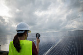 istock Engineer electric woman checking and maintenance of solar cells. 1178331864