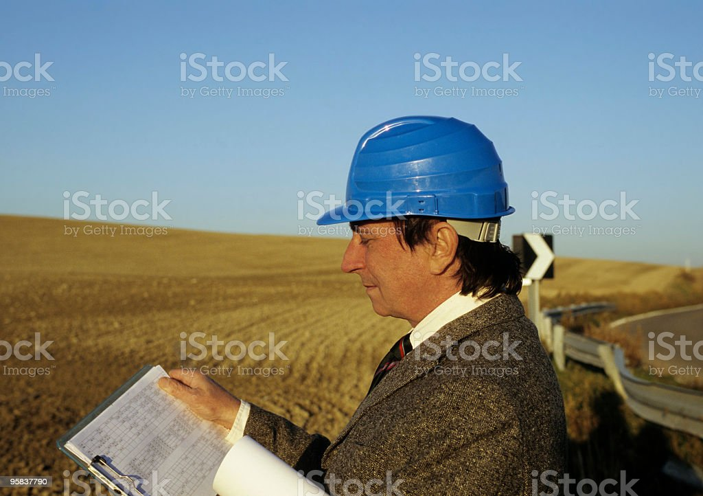 Engineer Examining Plan in the Country.Copy Space royalty-free stock photo