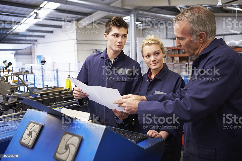 Engineer explains how to use tube bending machine royalty-free stock photo