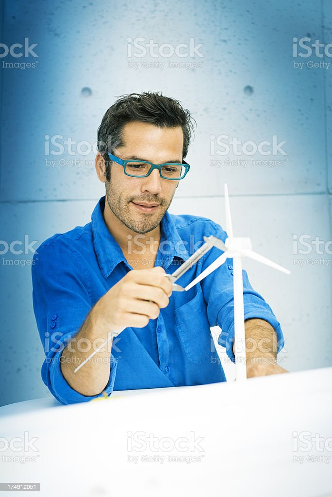 Engineer projecting new area of wind turbines. Focus on the hands and...