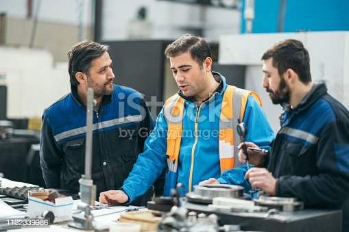 Engineer gives training to workers
