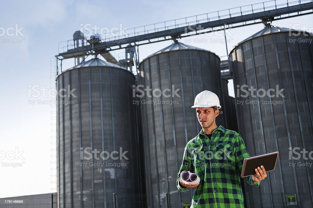 Engineer holding a digital tablet royalty-free stock photo
