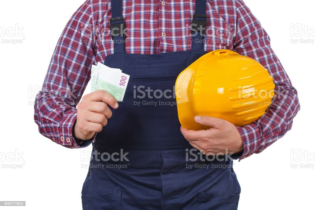 Engineer holding his helmet and  monthly salary stock photo