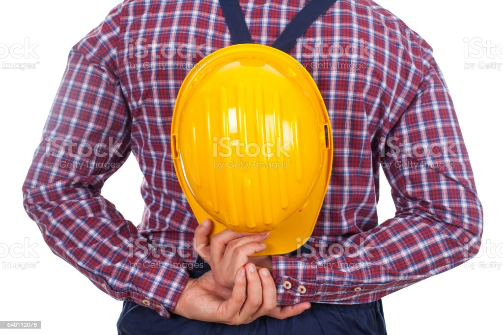 Engineer holding his helmet stock photo