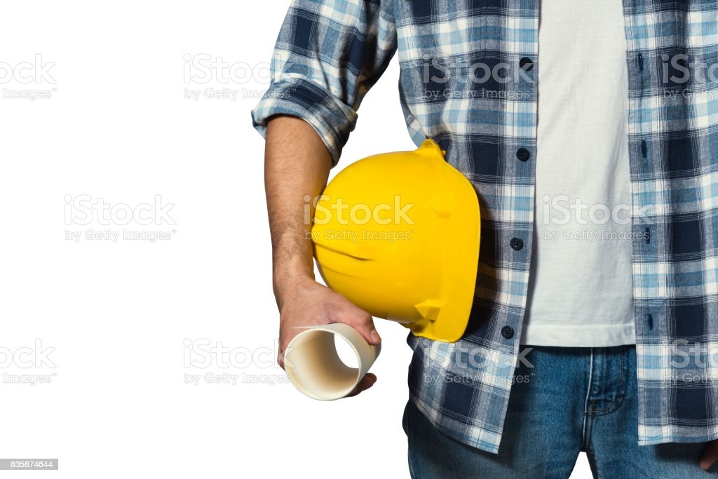 engineer holding yellow helmet for workers security stock photo