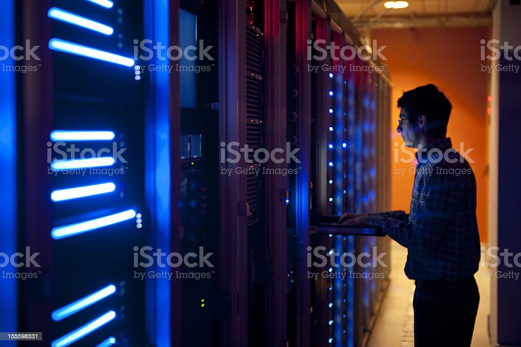 IT Engineer in Action Configuring Servers stock photo