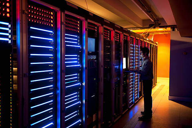 it engineer in action configuring servers - mainframe stock pictures, royalty-free photos & images