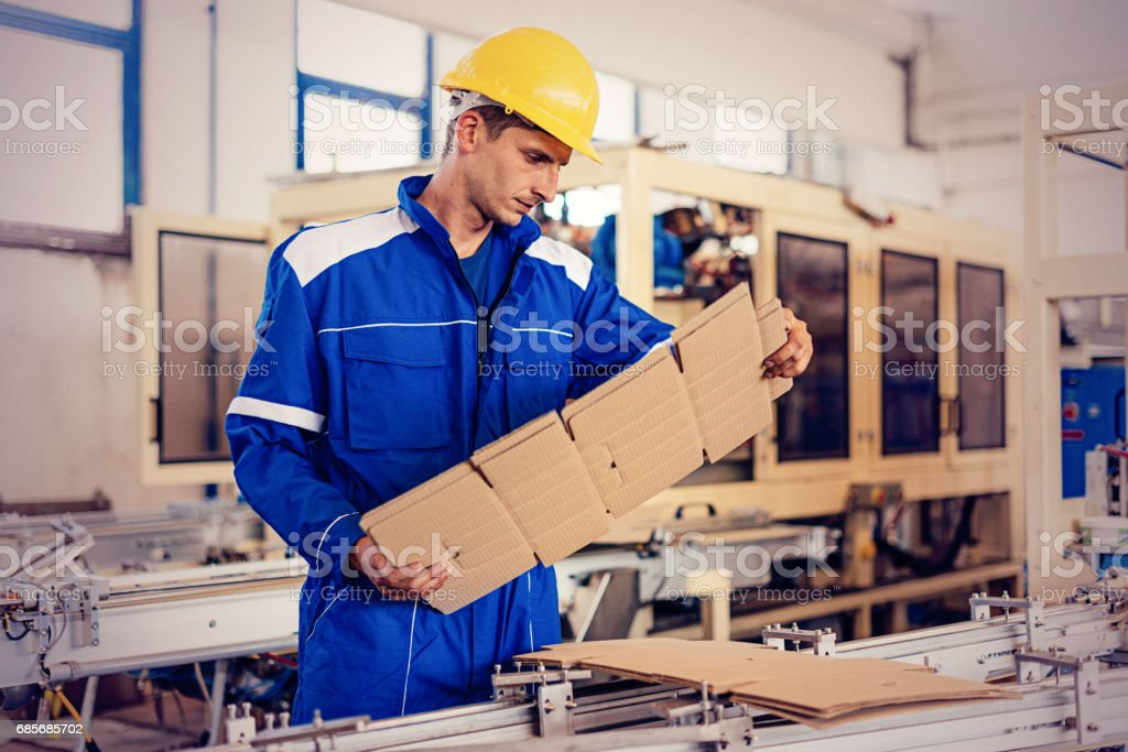 Engineer in factory checking quality of semi-product - foto stock