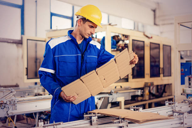Engineer in factory checking quality of semi-product stock photo
