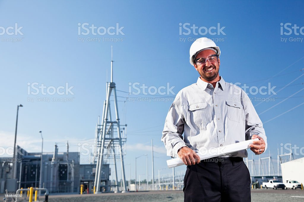 Engineer in parking lot of power station royalty-free stock photo