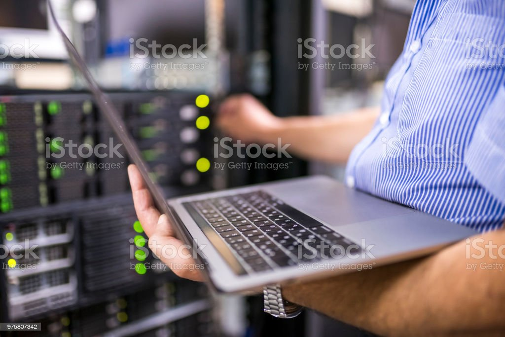 Engineer in the server room close-up stock photo