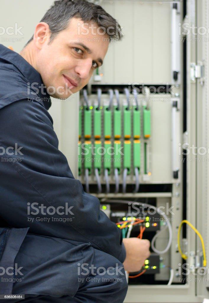 Engineer Insert Fiber Optic Cable on Server Network. stock photo