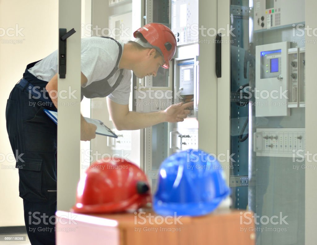 Engineer inspecting functionality of equipment stock photo